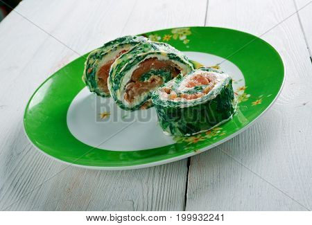 Courgette Herb Smoked Salmon Roulade close up meal