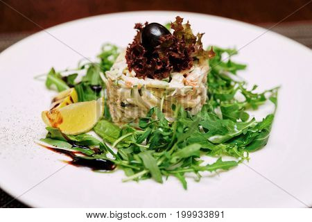 Seafood appetizer with crab and rocket salad, toned
