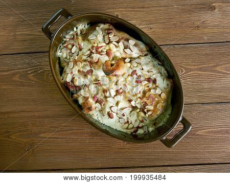 Flying Jacob - Swedish casserole that consists of chicken cream chili sauceroasted peanuts .