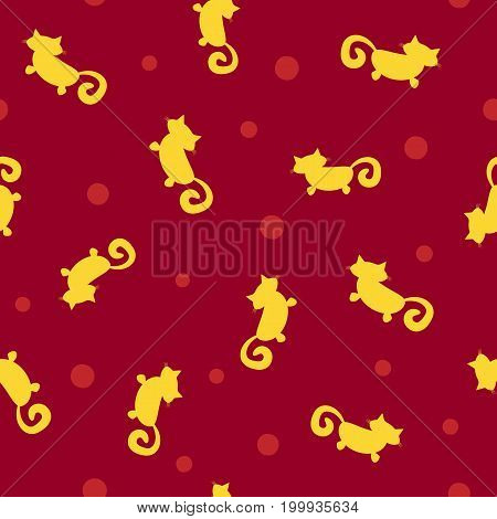 Abstract silhouettes of cats and polka dot. Cute seamless pattern. Red and yellow colour. Vector illustration.