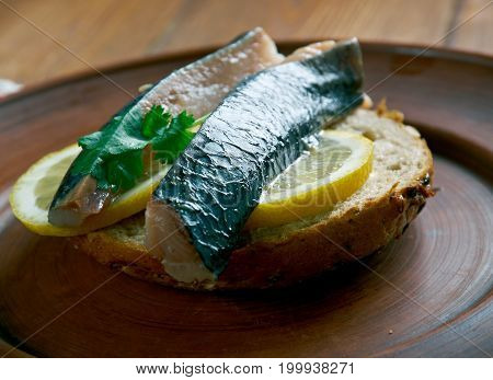 Soused herring- herring soaked in a mild preserving liquid. It can be raw herring in a mild vinegar pickle or Dutch brined herring