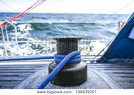 Kabestan with a rope on a yacht during a cruise on the North Sea.