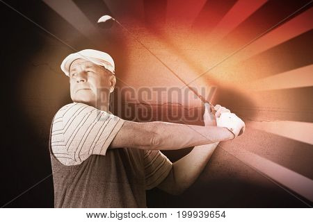 Sportsman is playing golf against concrete wall with crack