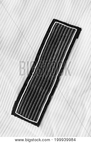 Black textile clothes label on white textile background