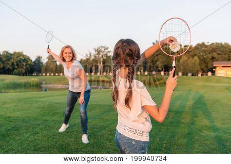 Woman And Granddaughter Playing Badminton