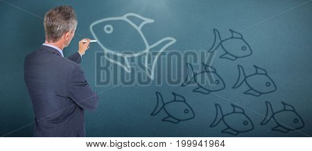 Businessman writing against blue