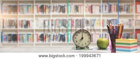 desk against multi colored bookshelf in library