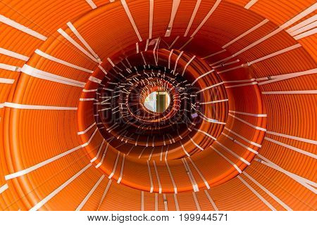 Abstract creative tunnel vision from packs of twisted orange hoses