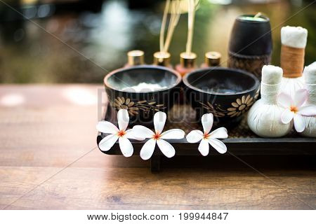 Spa Thai setting for aroma therapy and sugar and salt massage with flower on the bed relax and healthy care. Healthy Concept