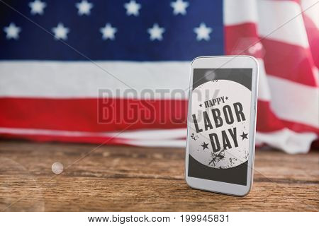Flare against american flag and mobile phone on table