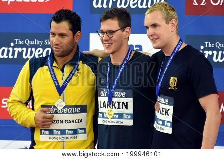Hong Kong China - Oct 30 2016. PINZON GARCIA Omar (COL) LARKIN Mitchell (AUS) and Peter BERNEK (HUN) at the Victory Ceremony of the Men's Backstroke 200m. FINA Swimming World Cup.
