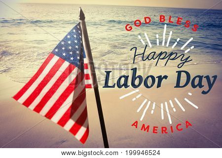 Digital composite image of happy labor day and god bless America text against beautiful beach on a sunny day