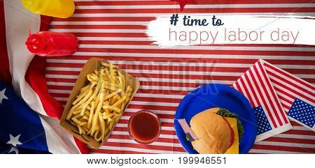 Digital composite image of time to happy labor day text against overhead view of french fries ad burger on tablecloth