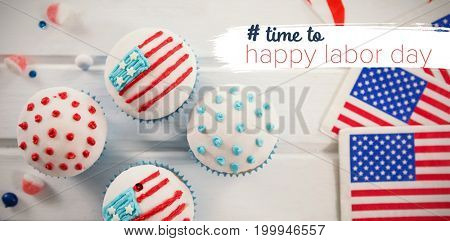 Digital composite image of time to happy labor day text against cupcakes with american flags on table