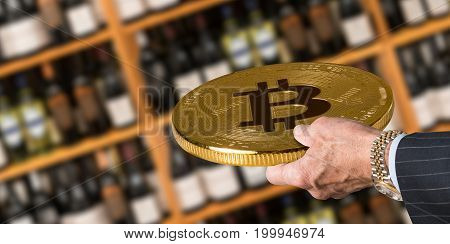 Businessman offering a bitcoin in payment for bottles of wine in wine store or supermarket in concept for e-commerce