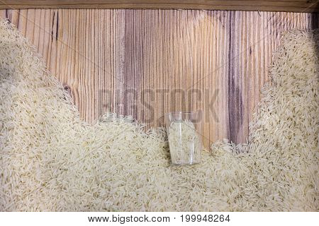 Top View Of Rice On Wooden Board