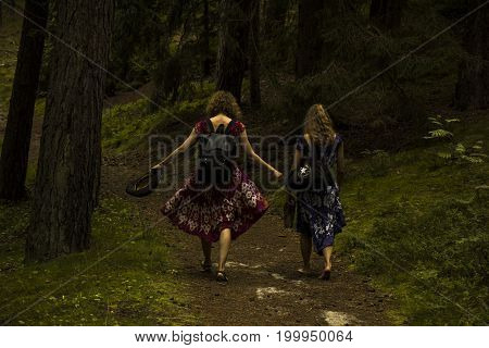 forest with pines near sea. And running girls