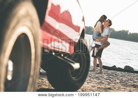 Couple Kissing On River Shore