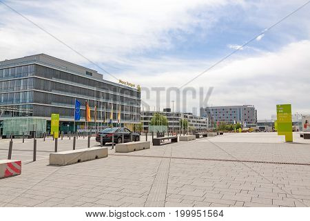 Stuttgart Germany - May 06 2017: Trade fair Stuttgart - administration building with corporate logo at building facade - square at entrance
