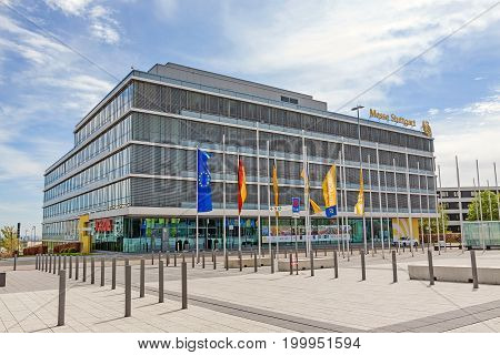 Leinfelden-Echterdingen Germany - May 06 2017: Trade fair Stuttgart - administration building with corporate logo at building facade - square at entrance