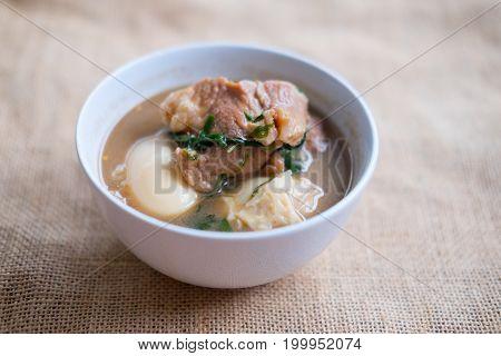 Stewed boiled egg with tofu and streaky pork call Khai Palo in Thai