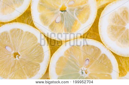 Fresh fruit in a cut as background. Pattern of citrus fruits. Diet and healthy food concept. Flat lay style.