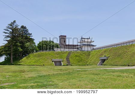 UTSUNOMIYA JAPAN - JUNE 2 2017: Reconstructed earthen wall and Fujimi Turret of Utsunomiya Castle Japan. Castle was founded in 1062 destroyed in Boshin War of 1868 and reconstructed in 2007