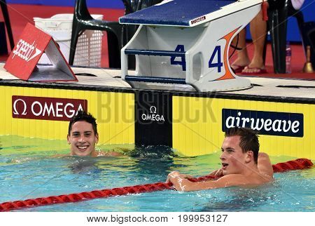 Hong Kong China - Oct 30 2016. The winner ROMANCHUK Mykhailo (UKR) and Gergely GYURTA (HUN) after the Men's Freestyle 1500m Final. FINA Swimming World Cup Victoria Park Swimming Pool.