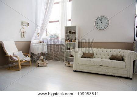 Interior Of The Room With A Baby Cot.
