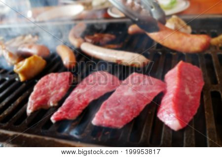 Blurred background of delicious wagyu meat vegetable and sausage yakiniku barbecue grill on oven