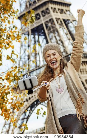 Tourist Woman Rejoicing And Taking Selfie On Embankment In Paris