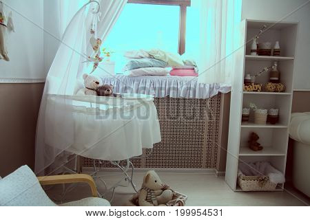 Interior Of The Room With A Cot And Window.