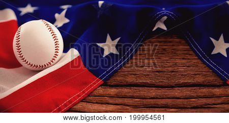 Close-up of baseball on American flag at table