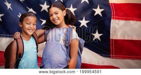 Portrait of smiling friends against close-up of red and white american flag