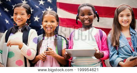 Portrait of friends with digital tablets against close-up of an flag