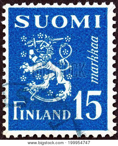 FINLAND - CIRCA 1948: A stamp printed in Finland shows coat of arms, circa 1948.