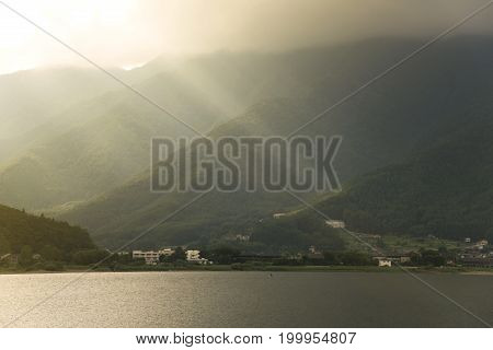 Lake Kawaguchi with sunset light and mountain background in Japan.
