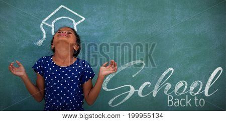 Back to school text over white background against happy girl with head back by blackboard
