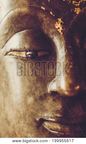 Close Up Image On Face On Buddha Head Statue.