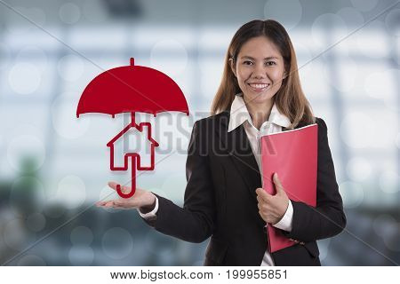 salesman agent hand holding umbrella protection home. concept accident prevention healthcare insurance.