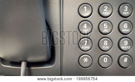 Closeup dial telephone keypad concept for communication contact us and customer service support.