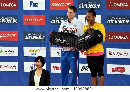 Hong Kong China - Oct 30 2016. Cluster winners MOROZOV Vladimir (RUS) and ATKINSON Alia (JAM) with gift bag. FINA Swimming World Cup