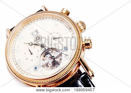 watch with visible mechanism on white.  men's accessory and time management concept.