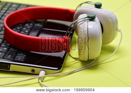 Music And Digital Equipment Concept. Headphones And Black Laptop