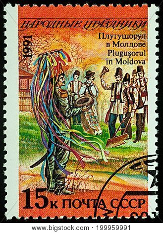 Moscow Russia - August 14 2017: A stamp printed in USSR shows Plugusorul (New Year) holiday in Moldova series