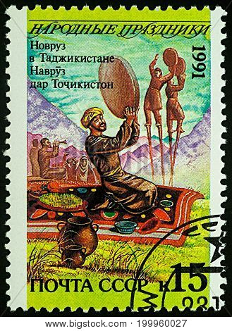 Moscow Russia - August 14 2017: A stamp printed in USSR shows Navruz holiday in Tajikistan series