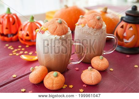 Hot chocolate with marshmallows in a pumpkin shape