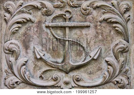 Metal artwork depicting an aged fouled anchor.