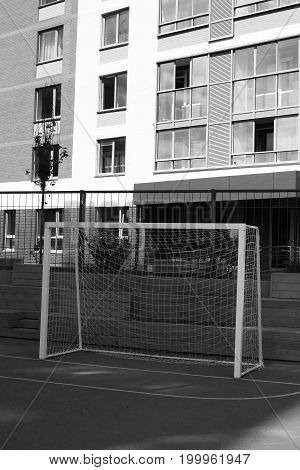 Football Gate Into The Yard Of A House