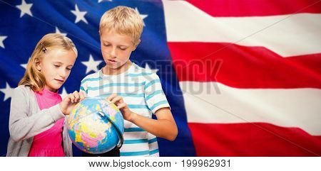 Friends looking at globe against close-up of us flag